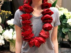 Lei  2 dozen roses  1 straight, heavy-duty hand needle (the largest from this Singer pack is recommended)  2 yards clear fishing line  1. Cut rose stems at the sepals, as close to the base of the bloom as possible.2. Thread needle with fishing line, pulling through to create two strands of equal length. 3. Knot the strands together about 4 inches from their end. 4. Grab a rose and work the needle vertically through the stem's nub and up through the center