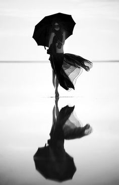 Photo by Alexey Pedan. S) Black and white water reflection with shades of grey for a perfect photo!
