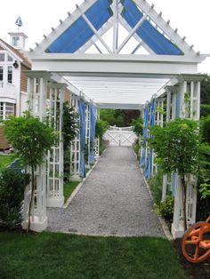 a garden pergola in Bridgehampton with Sunbrella panels