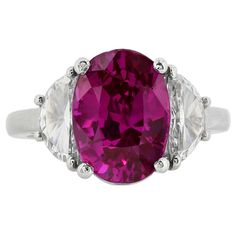 6.44 Carat Purple Pink Unheated Sapphire Diamond Platinum Three Stone Ring | From a unique collection of vintage three-stone rings at https://www.1stdibs.com/jewelry/rings/three-stone-rings/