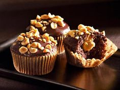 Get Peanut Butter Cream-Filled Devil's Food Cupcakes Recipe from Food Network