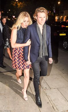 Date night: Ellie Goulding snuggled up close to her boyfriend Dougie Poynter as the couple left the Chiltern Firehouse in London on Wednesday night