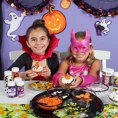 There's no better way to get kids into the Halloween spirit than with sweet treats. Make cupcakes in themed baking cups and set out small bowls full of icing decorations and sprinkles. Give each child a dessert plate to work on and let them start making some cupcake magic.
