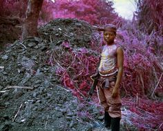 infra photo series employs infrared color film to investigate a jungle war zone in the democratic republic of congo, resulting in tragic scenes in vivid lavender, pinks and reds. Infrared Photography, War Photography, Inspiring Photography, Color Photography, Magenta, Richard Mosse, Fotojournalismus, Photoshop, Portraits