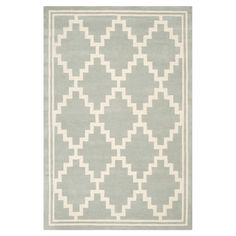 Add a pop of pattern to your living room or den with this hand-tufted wool rug, showcasing a trellis motif in grey.  Product: Ru...