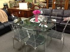 Glass and Acrylic Dining Table & Chairs - Single pedestal table with glass top. Two fold out glass leaves to extend the table an additional 34 inches.  Size is 43 inches by 43 inches and 43 by 67 inches with leaves extended.  Great looking acrylic chairs (6 chairs) with leather seat covering Item. 190-6  Price 1800.00   - http://takeitorleaveit.co/2013/08/21/glass-and-acrylic-dining-table-chairs/