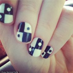 Ying yang: Zooey also tweeted a snapshot of her b&w-checkered manicure courtesy of Tom Bachik