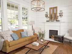 Since shiplap was commonly used as insulation in farmhouse-style homes, check under the existing wall surface before starting a renovation project. In this home featured in HGTV Magazine, designer Joanna Gaines found shiplap walls hidden under crumbling wallpaper. She peeled off the dated pattern and reinvigorated the room with a fresh coat of white paint.