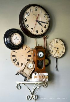 funky junk interiors Fun collection of clocks. I have that same school house style one! (and I love the quirkiness of the little one tipped on its side.) http://s.bhome.us/NbW8QLWd via bHome https://bhome.us