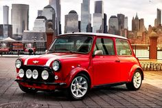 Built as a one-off for the New York International Auto Show, this Classic Mini Electric Car offers a glimpse of the company's future through the lens of the past. The instant power offered by the electric motor is ideally suited. Mini Cooper Classic, Mini Cooper S, Classic Mini, Mini Morris, Mini Countryman, Small Luxury Cars, Small Cars, Bmw I3, Bmw Classic Cars