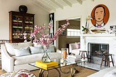 How An East Coast Designer Styled Her California Home #refinery29  http://www.refinery29.com/one-kings-lane/17#slide-2  The sitting room is an airer take on New England style. DeKwiatkowski topped a pair of stylized ram's heads with glass to make the coffee table, while a piece by British artist Julian Opie hangs over the mantel....