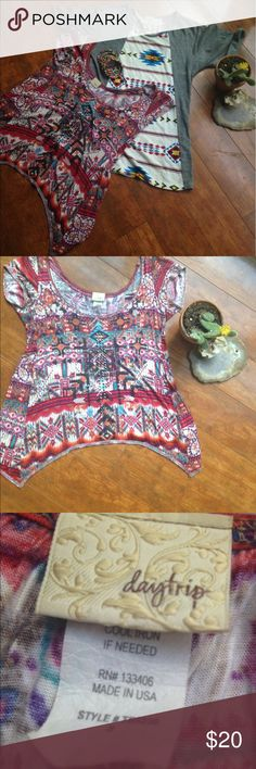 Aztec printed shirts❤️ These two shirts are super stylish and super trendy! The first has an open back at the bottom, super flattering with dark jeans. It has detailing down the front (refer to picture).The second is a little more fitted and a little longer. Both can be dressed up or dressed down! Happy to answer any questions, check out my closet so you can bundle and save! (Listing does not include bracelet) Tops Tees - Short Sleeve