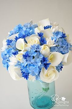 The bouquet consists of champagne ivory roses, ivory callas, ivory tulips, tuberose, with light blue hydrangeas, as well as light and dark blue hyacinth.