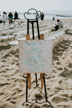 Wedding sign for beach wedding - wooden sign with light blue text {Emily Magers Photography}