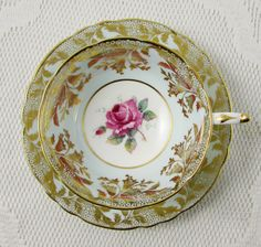 Paragon Blue Tea Cup and Saucer with Rose Center and Gold Decor, Bone China