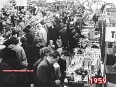 A family group choose Christmas Toys in the F.W. Woolworth store in Briggate, Leeds, West Yorkshire, UK in 1959. The picture shows how families would dress up to go to the shops in days gone by. In the foreground in this Saturday picture both dad and lad are wearing a tie.
