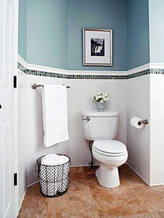blue mosaic tiled wall border above a WC