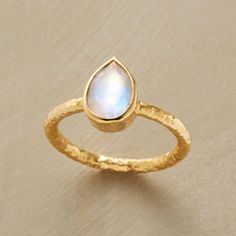 DROP OF MOONLIGHT RING -- Like a drop of moonlight, our handcrafted moonstone drop ring shimmers with iridescence. Band and bezel of 22kt vermeil. Whole and half sizes 5 to 9.
