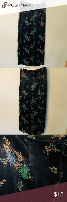 Vintage Kimono-Inspired Skirt Black silky skirt with Asian-inspired designs. Slit up the side measures about 18in and the skirt is about 35in from top to bottom. Hits around the calf. Needs to be pressed b'real Skirts Midi