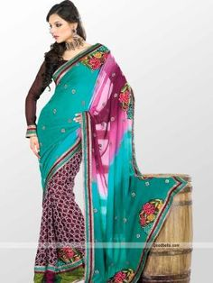 Designer look saree embellished with blend of multicolor. Printed skirt part with beautiful embroidered butti work pallu in multi shades gives it trendy look. Heavy look border is enhancing its richness. It will look good for kitty or semi-formal parties. http://goodbells.com/saree/designer-printed-green-saree-with-butti-work.html?utm_source=pinterest_medium=link_campaign=pin08AugR32P148