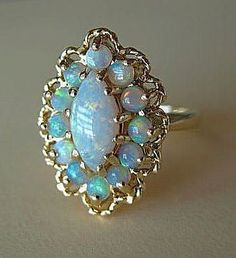<3 Vintage 14K YG Genuine Australian Crystal Opal Cocktail Ring. I really love the colors in this ring!!!