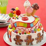 Land o' Candy Birthday Party: The iconic colored squares will lead happy tasters past a lollipop forest and gumdrop mountains to the ice-cream-cone castle on this candy covered cake. From @Parents Magazine