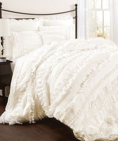 This beautiful ivory set adds a luxurious touch to bedroom décor. Layered ruffles and ultra-soft fabric create the perfect haven for rest and relaxation. Includes comforter, bed skirt and two shamsAvailable in multiple sizes100% polyesterDry cleanImp...