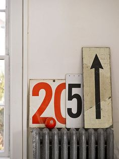 This idea of mixing and matching signs with numbers & symbols is great - especially love that its on a radiator.