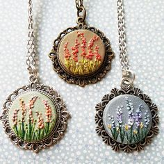 A garden of embroidered pendants. A garden of embroidered pendants. Garden Embroidery, Embroidery Flowers Pattern, Silk Ribbon Embroidery, Embroidery Jewelry, Hand Embroidery Patterns, Embroidery Thread, Clay Jewelry, Jewelry Crafts, Brazilian Embroidery