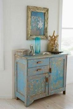 This is a nice piece of blue distressed furniture. Learning how to distress furniture isn't hard!