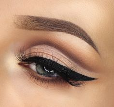 Champagne and brown cut crease smokey eye with winged liner.