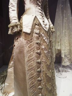 Closeup detail of the Worth wedding gown from 1880.    V Museum