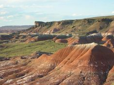 "Painted Desert at the Petrified Forest National Park. ""The Petrified Forest is as amazing as the Grand Canyon."" Walk some of the trails and stop at the visitor centers. Petroglyphs. No shade - take cold water and a hat."