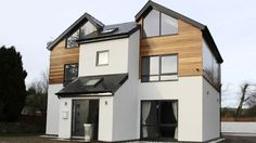 Western Red Cedar Cladding against white render on Self Build Property Wooden Cladding Exterior, Western Red Cedar Cladding, Larch Cladding, House Cladding, Home Exterior Makeover, Exterior Remodel, Rendered Houses, Bungalow Exterior, Modern Exterior