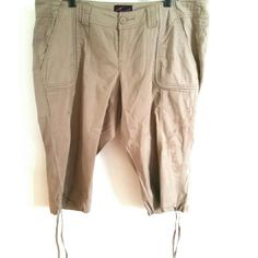 """Torrid 16 Long Bermuda Cargo Shorts / Short Crops These Torrid size 16 Tan Long Shorts or Short Crops are gently used and in great condition with one exception: the tiny pinhole on the bum (highlighted in last photo--in the middle of that viewing circle). Waist: 22"""" across laying flat, so 44"""" around. Inseam: 19"""". Use the drawstrings to cinch these up to knee length like cargo bermudas. Sold as is. ::: Bundle 3+ items from my closet and save 30% off when you use the app's Bundle feature…"""