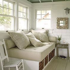 I could do a narrower version of this in our sunroom - maybe a narrow Ikea bookcase on its side with foam cushion on top.