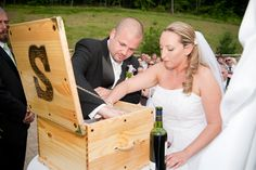 The Wine Box Ceremony is gaining in popularity - and for good reason. Here a couple I officiated for is putting the box   together - the groom built the box himself.