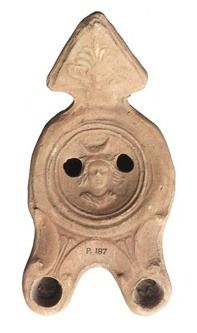 An ancient Roman multiple-nozzle lamp with a bust of the moon goddess Luna, with a crescent, her attribute, over her head. (Museum of London)
