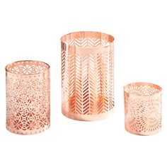 Fine ornamental work defines Danya B. Set of 3 Rose Gold Filigree Hurricanes. Light a tea light, votive or small pillar candle in each of the hurricanes and watch them cast intricate shadows that will transform any part of your home into a magical place. Each piece of the Danya B. Set of 3 Filigree Hurricanes has a different filigree pattern in rose gold tone that when placed on a table or shelf will add a touch of on trend metallics to your home decor. Indoor use only.