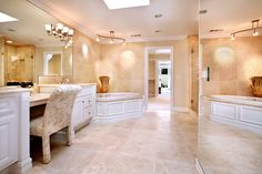 Love this big bathroom with the vanity and chair to do makeup in! :)