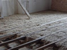 check it out - making the floor, with hemp straw insulation. Smells nice. #ecohousematerials
