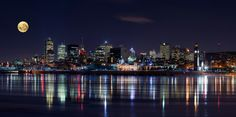 As Montreal is reflected in still waters, the beauty of the illuminated city is instantly doubled. The impressive, modern architecture glows under the dark sky where a full moon gradually rises. Photography by YuppiDu. Oh The Places You'll Go, Great Places, Places To Travel, Beautiful Places, Places To Visit, Vacation Places, Montreal Qc, Montreal Ville, Ottawa