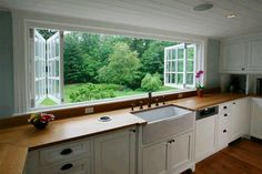 Kitchen with insane retractable windows. What a view!