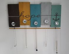 Jewelry organizer/ Hope necklace hanger made with 5 solid oak upcycled pallets. Quality handmade one of a kind design created by Sparrow Artisan Designs. Necklace Hanger, Jewelry Hanger, Pallet Crafts, Wood Crafts, Pallet Ideas, Jewelry Wall, Jewelry Boards, Barn Wood Projects, Pallet Projects