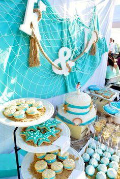 Dessert table- Dessert table-beach theme #seashells #starfish #oystercookies #cake #cupcakes