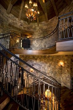 Love the rock walls and spiral stairway....