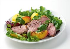 Gressingham duck breasts with a summer peach, mango and avocado salad