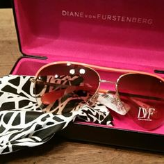 Price Lowered! Diane Von Furstenberg Aviators Aviator sunglasses. The lenses have a brown tint while the top bar and ear pieces are orange. The tag is still attached and retails for $150. The sunglasses come with a bag and hard case. Diane von Furstenberg Accessories Sunglasses