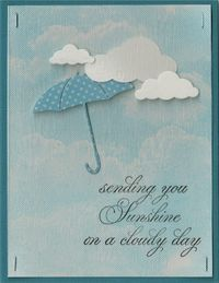 puffy clouds and petite umbrella  and note the cloud background.  Wonderful!