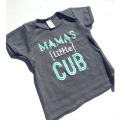"Revamped with MINT INK to match our Spring Line!You've seen our ""Mama's Cub"" tees, well and now we added ""Mama's (little) Cub""! Because some mama's have more than one cub! The perfect unisex / gender neutral shirt for your Cub!  Infant Lap TeeColor is Asphalt - Ink is White 100�0Baby Rib cotton construction (Heather Grey contains 10�0Polyester)Neckband designed for easy on-and-off Shrinkage: will shrink an average of one size when put in the..."